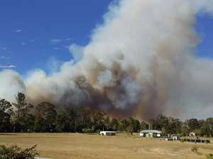 Families evacuated, roads closed as bushfires rage
