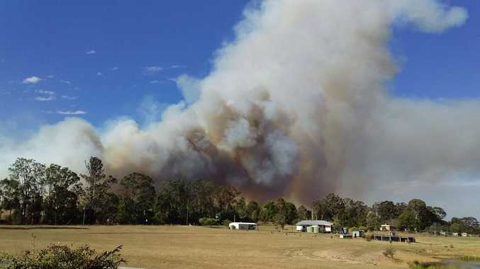 Familes evacuated, roads closed as bushfire rages