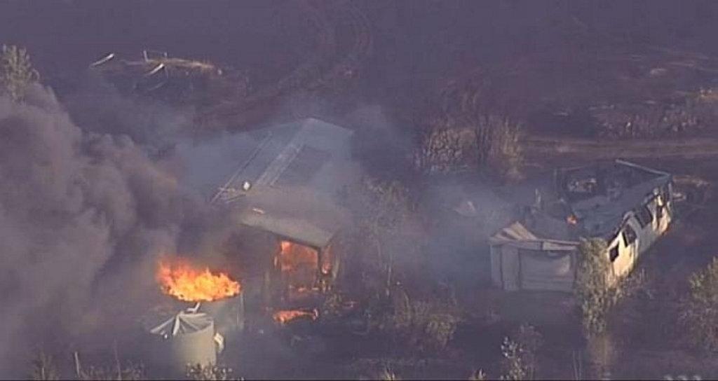 A bushfire destroys properties at Mount Beppo, near Toogoolawah.