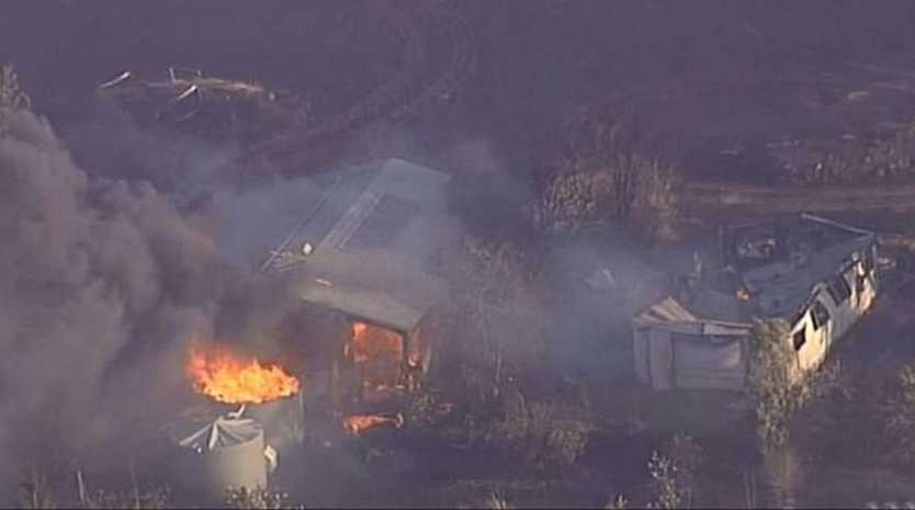 A bushfire destroys properties at Mount Beppo, near Toogoolawah.