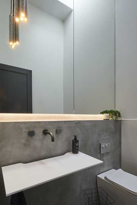 The judges loved how the mirror and pendant light accentuated the height in Bianca and Carla's powder room.