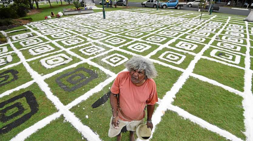 FUN AT WORK: Lismore-based Bundjalung artist Digby Moran creates a large-scale artwork outside Lismore City Hall as part of Artstate, Lismore.