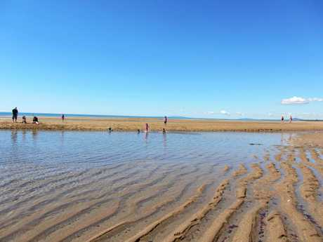 The lagoon at Tannum Sands Main Beach appears at low tide and is the perfect place for children to play and swim safely.