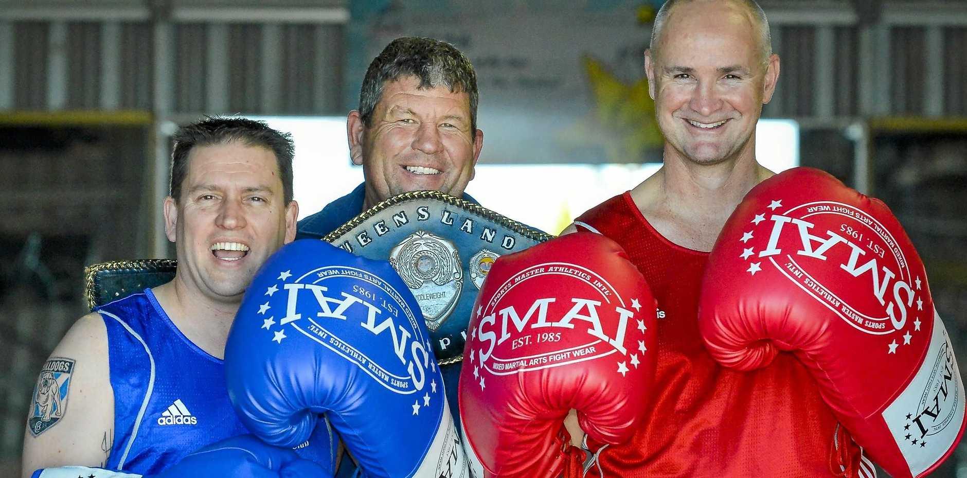 IT'S ON: Mayor Matt Burnett, Mick Daly and MP Glenn Butcher are ready for tonight's charity boxing match.