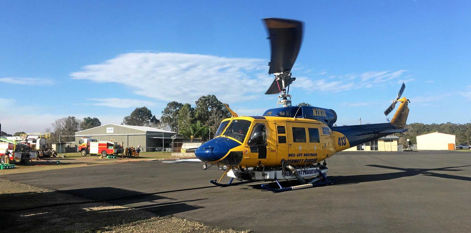 A McDermott Aviation Group Bell 214 fire fighting helicopter refuels yesterday and reloads 3000 litres of water in just 40 seconds.