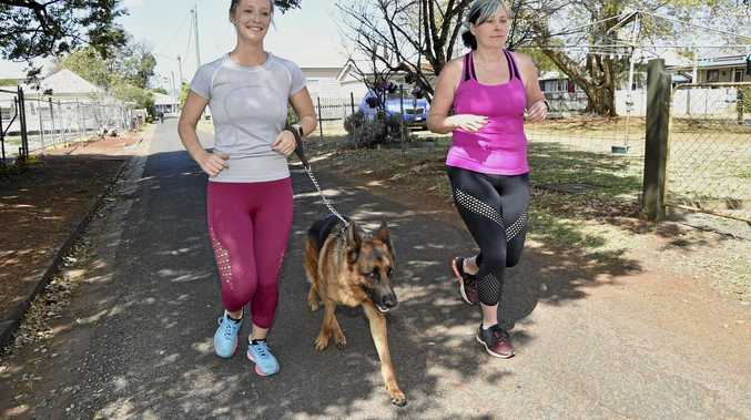 First time Toowoomba Hilly Half Marathon competitors Sally Gersekowski (left) and Amanda Goebel get in some training this week with running mate Lenny.
