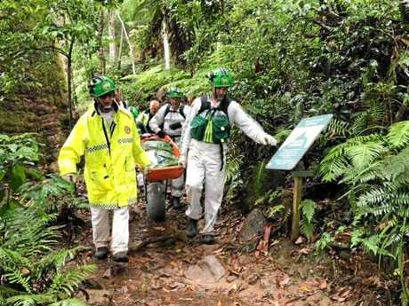 A hiker being rescued from Mt Warning by the association.