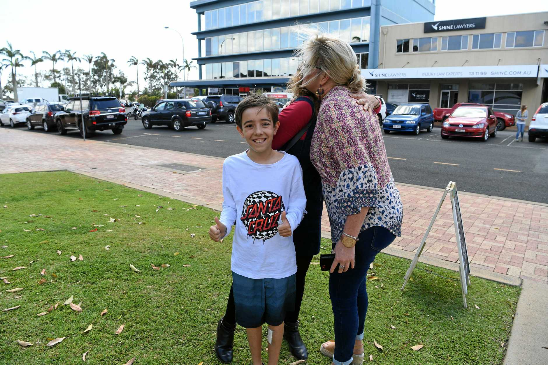 THANK YOU: Nagua Soliman-Kross hugs good Samaritan Wendy Cheshire, who helped when son Absalom was hit by a ute this week.