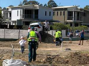 Man, 70, crashes through fence into construction site