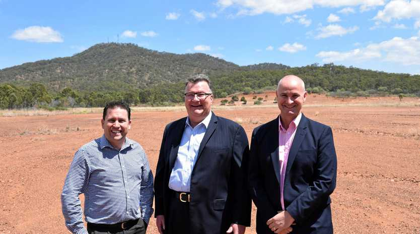 Gladstone Region mayor Matt Burnett, Australian Future Energy chief executive officer Kerry Parker and Member for Gladstone Glenn Butcher at the site of $1 billion Gladstone Energy and Ammonia Project located in the Gladstone State Development Area at Yarwun.