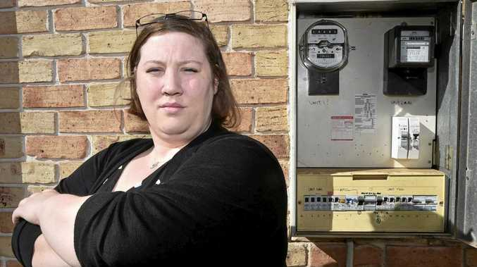 POWER PRICES: Ashly Peterson is looking for answers after she and other Toowoomba residents have had a nasty shock with their power bills doubling.