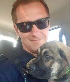 FOUND: Constable Hayden Drinnen assists with return of puppy.