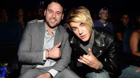 Scooter Braun and Justin Bieber attend the 2015 MTV Video Music Awards.