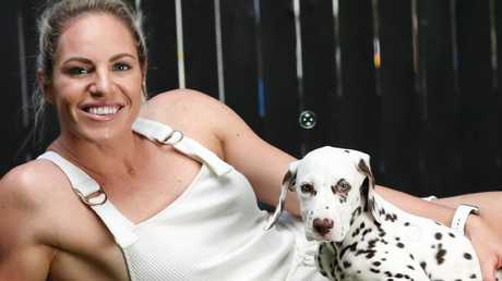 Emily Seebohm with her new puppy, Pongo. Picture: Nigel Hallett