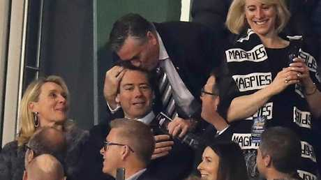 Magpies president Eddie McGuire kisses AFL chief Gillon McLachlan. Picture: AFL Media