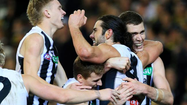 Collingwood players celebrate against the Tigers. Picture: Mark Stewart