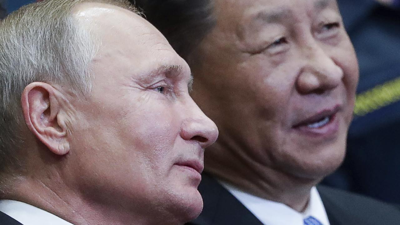 Russian President Vladimir Putin, left, and Chinese President Xi Jinping visit the Ocean Russian children recreation center after at the Eastern Economic Forum in Vladivostok, Russia. Picture: AP