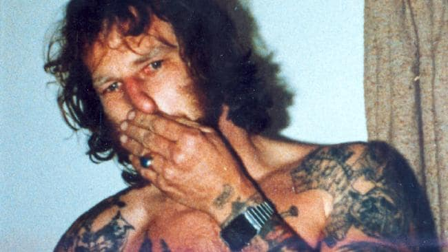 Photos of John Victor Bobak's tattoos. On his lower left arm a horse. On his upper right arm an eagle and a skull which covers his shoulder. The word 'Ford' is on his right lower arm and an eagle's head and hula girl on the front. On his right upper arm is a spider's web (on shoulder) and a snake on the front. On his left upper back is a skull. On his right upper back is a panther and left upper
