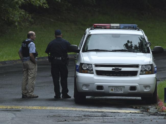 Authorities said a suspect was in a critical condition after a handgun was fired at a drugstore distribution centre. Picture: Jerry Jackson /The Baltimore Sun via AP