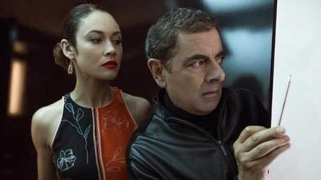 Olga Kurylenko as Ophelia and Rowan Atkinson as Johnny English.