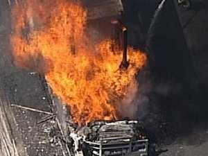 Police raid Banksmeadow company after fiery M5 crash