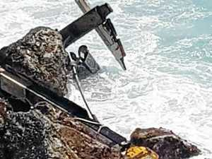 Boat damaged after being washed out to sea