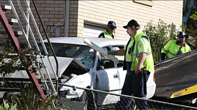 Investigators at the scene of a fatal crash at Stafford.