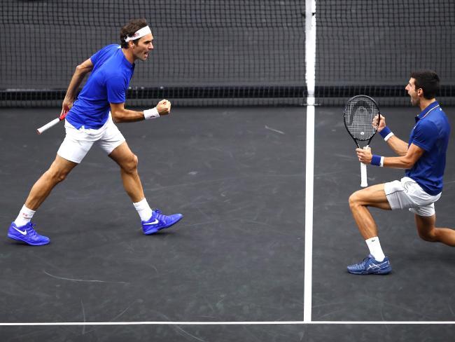 Roger Feder and Novak  Djokovic celebrate a won point.
