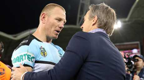 Luke Lewis is congratulated by Storm coach Craig Bellamy on a great career. Picture: Getty