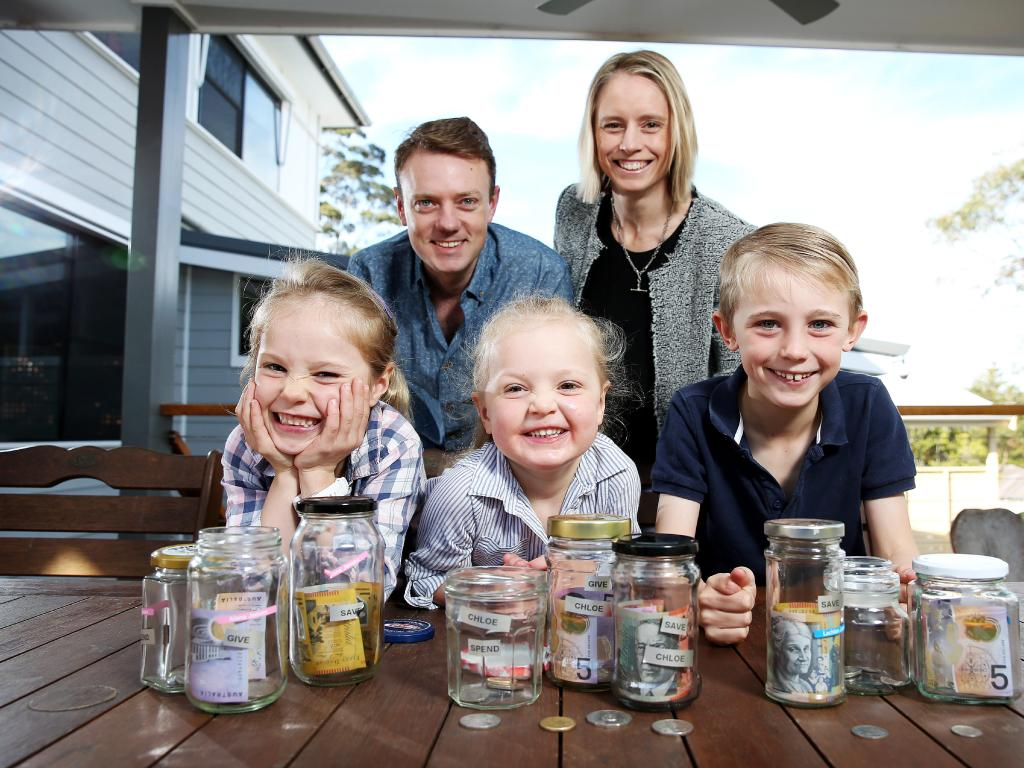 Teira and Peter Jansen with their kids Lachlan 8, Alana, 6, and Chloe, 3, at home in Forestville today. Picture: Tim Hunter.