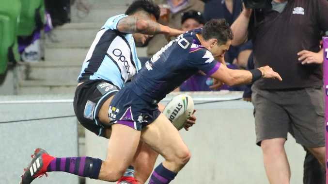 Billy Slater collides with Sosaia Feki on Friday night. Picture: Scott Barbour/Getty