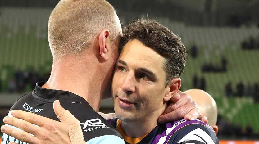 Billy Slater gets a hug from Luke Lewis at the end of Friday night's match. Picture: Getty