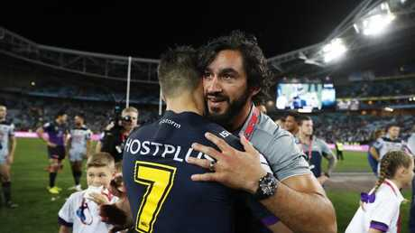 Cronk is congratulated by Thurston after last year's grand final. Picture: Brett Costello