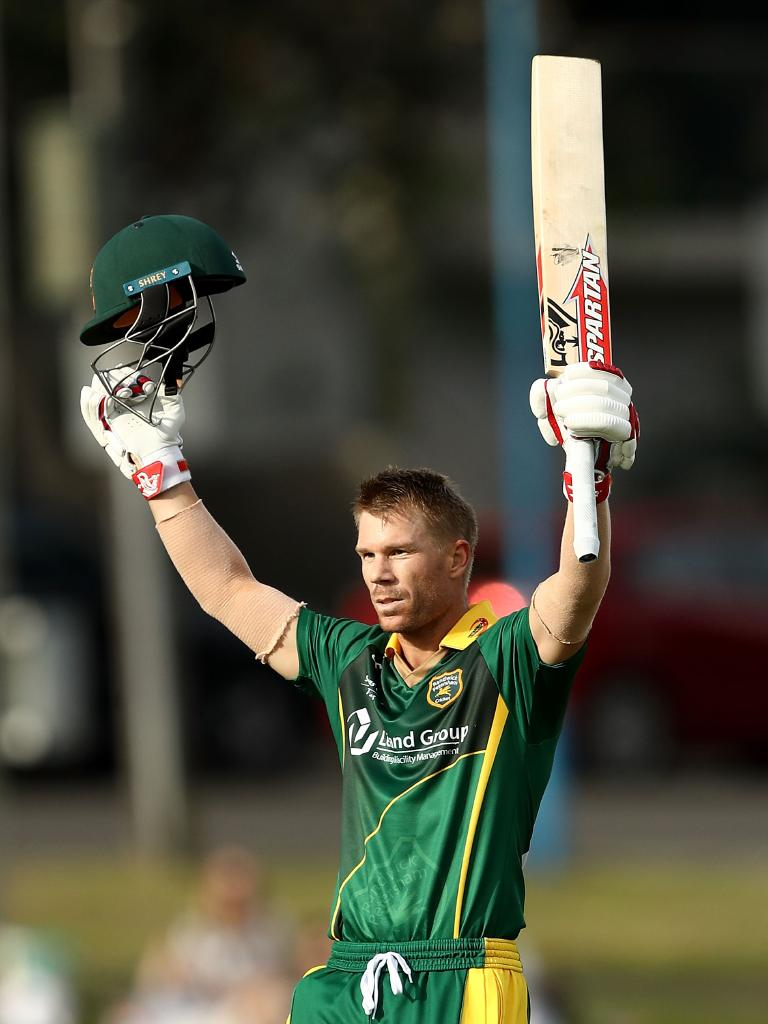 David Warner raises his arms in triumph upon reaching his ton. Picture: Getty