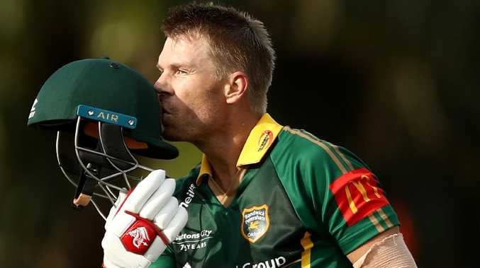 David Warner kisses his helmet after reaching his century at Coogee Oval. Picture: Ryan Pierse/Getty