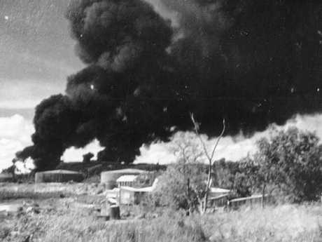 Black smoke covers the Darwin skyline after the Japanese launched 188 fighter planes against Darwin on February, 19, 1942, the first of many bomb attacks on the city. Picture: News Corp Australia