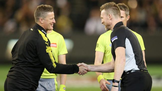 Richmond coach Damien Hardwick and Collingwood coach Nathan Buckley shake hands before the game. Picture: Michael Klein