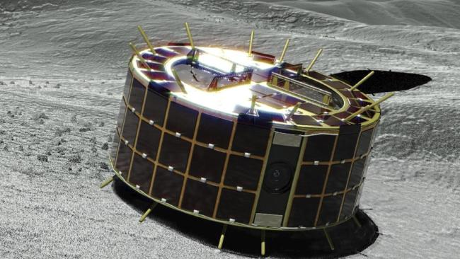 This computer graphic image provided by the Japan Aerospace Exploration Agency (JAXA) shows a drum-shaped and solar-powered Minerva-II-1 rover on an asteroid. Picture: JAXA via AP.