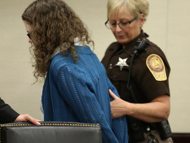 Natalie Keepers is lead away in handcuffs after being found guilty by a jury of being an accessory before the fact for the 2016 murder of Nicole Lovell. Picture: AP