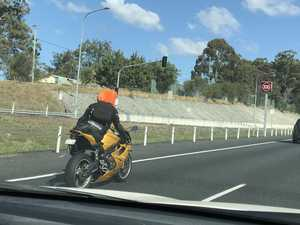 Motorcyclist's silly stunt at 100km/h