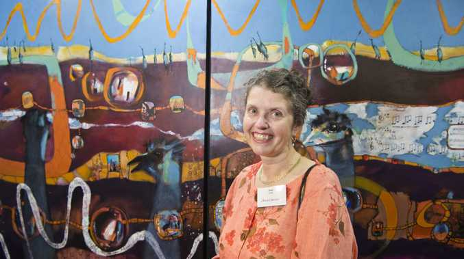 Jane Caraffi of Art on Cairncross represents feature and former Toowoomba artist Rex Backhaus-Smith with some of his work at the Downlands Art Exhibition, Friday, September 21, 2018.