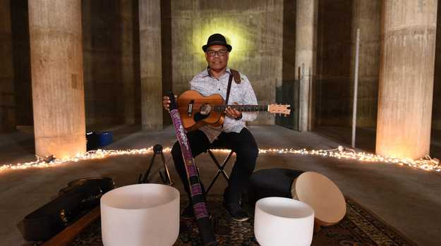 Maryborough Open House - musician John Corowa performing in the Ann Street water tank.