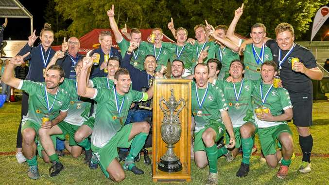GREAT GRUBS: Clinton players celebrate their grand final win against Cap Coast in the Central Queensland Premier League division 1.