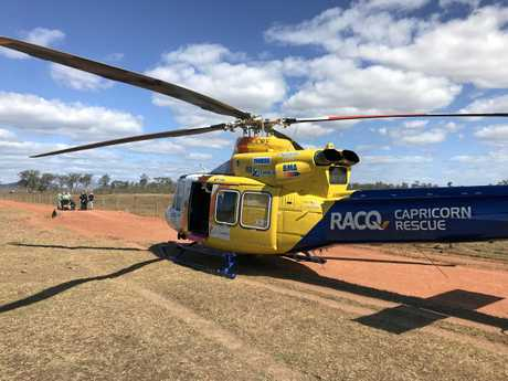 The RACQ Capricorn Helicopter Rescue Service attends to an injured man north of Marlborough following a horse fall accident.
