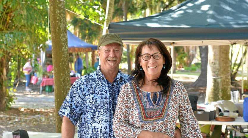 Husband and wife Morrie and Norma Hokins selling their buds at the Mackay Orchid Extravaganza