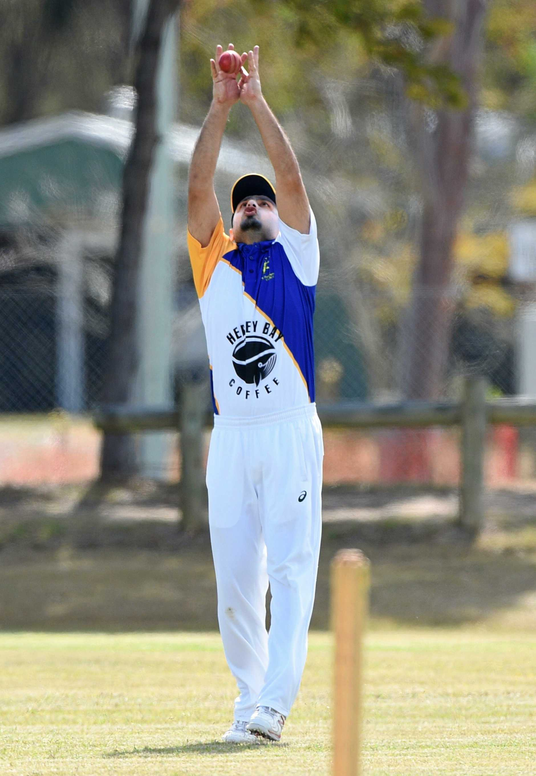 Hervey Bay cricket - Cavaliers (batting) v Bushrangers (fielding). Zubair Khan takes a catch in the outfield.