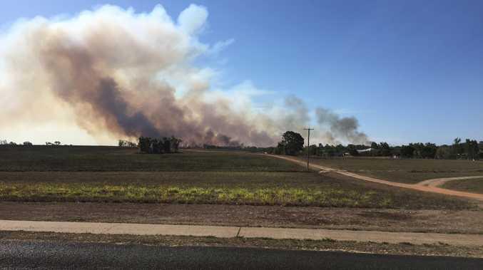 BREAKING: Water bombing under way at raging Fairymead blaze