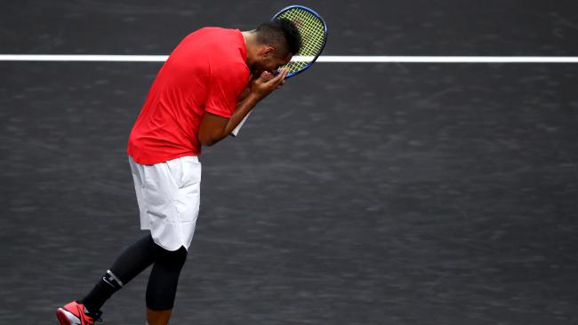 Team World star Nick Kyrgios reacts after losing a point to Roger Federer. Picture: Getty