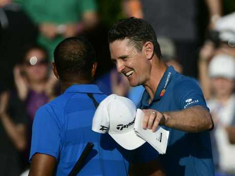 Justin Rose congratulates Tiger Woods. Picture: AP