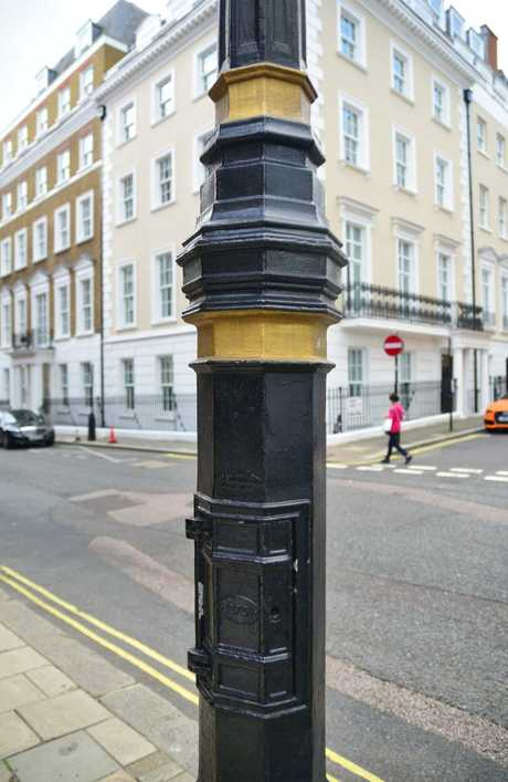 The Russian KGB used to hide notes for their agents inside the hinged compartment of this lamp post in London. Picture: Ronan O'Connell